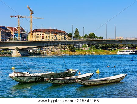 Basel, Switzerland - 27 August, 2016: the Rhine river as seen from the city of Basel. The Rhine is a European river that begins in the Swiss canton of Graubunden in the southeastern Swiss Alps and empties into the North Sea.