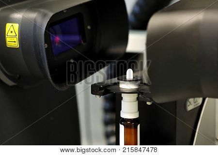 The Worker Measures The Size Of The Particles And Drops Of The Spray. Pharmaceutical Industry And La
