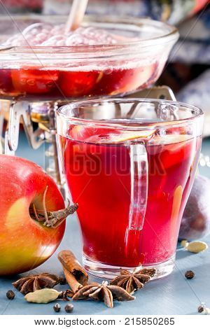 Prepare mulled wine on an open fire. To cook a punch. Glass glasses with mulled wine and Grog. Spices, fruit. Hot wine for winter