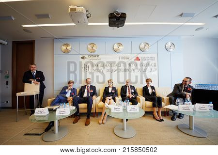 MOSCOW, RUSSIA - SEP 20, 2017: Group of employees of Cushman and Wakefield at press-breakfast for representatives of business and profile media about commercial real estate market in 2018 .