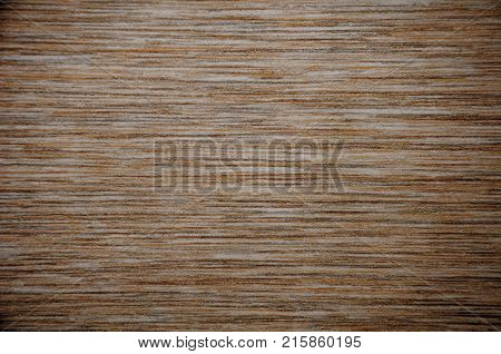 Dark brown dirty background with a chaotic interweaving of colored bands