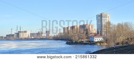 View of Neva river and microdistrict Ribatskoe on the outskirts of St. Petersburg at winter day Russia. poster