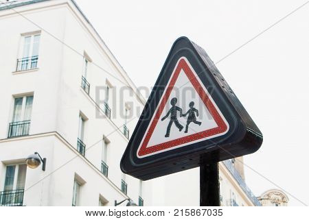 Red Caution Sign With Two Human Figures, Adult And Child Walking. School Warning Sign In The City.
