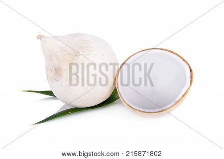 whole and half cut young coconut with leaf on white background