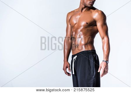 cropped shot of sweaty shirtless african american sportsman posing isolated on grey