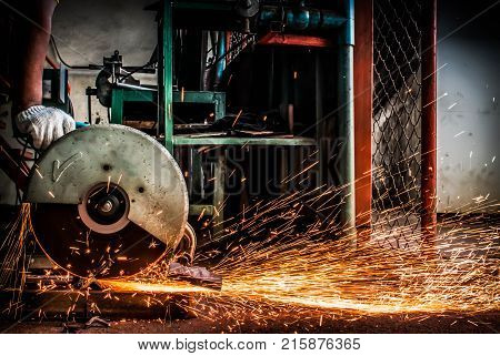 Worker are using electric cutting steel machine background