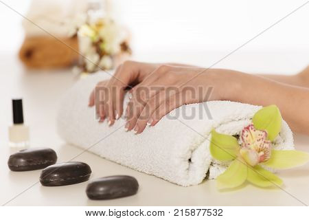Well manicured female nails. Spa concept. French manicure.