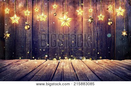 Glowing Christmas Stars Hanging At Rustic Wooden Background, 3d-lllustration