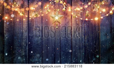 String Light Hanging At Vintage Wooden Background