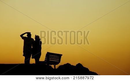 Silhouette of a couple in love on the beach at sunset.Love story.Man and a woman on the beach.