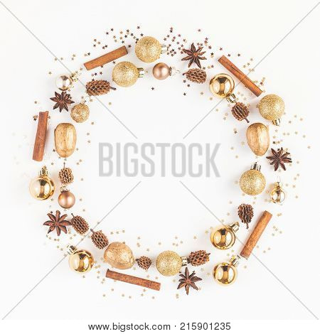 Christmas Composition. Christmas Wreath Made Of Pine Cones, Golden Decorations, Cinnamon Sticks, Ani