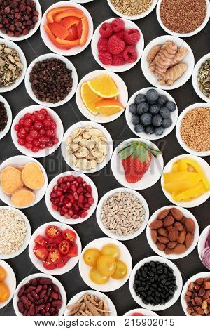 Healthy diet food to promote heart health with super food of fruit, vegetables, seeds, nuts, spice and herbs used in herbal medicine. High in omega 3 fatty acids, anthocyanins and antioxidants.
