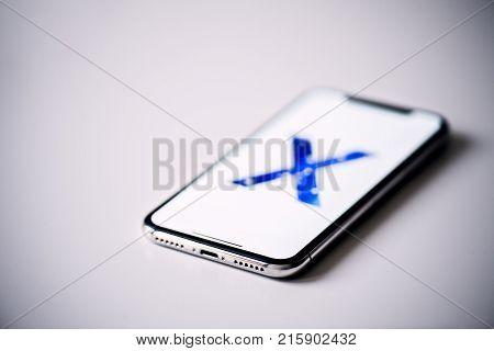 NOVA BANA, SLOVAKIA - NOV 28, 2017: New Apple iPhone X smartphone isolated on gray background.