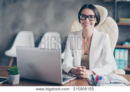 Portrait Of Confident Smart Successful Beautiful Businesswoman Wearing White Jacket, She Is Sitting