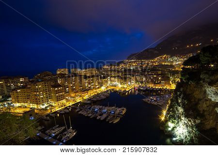 Panoramic view of Port de Fontvieille at night in Monaco. Azur coast. Luxury yachts in Monte Carlo.