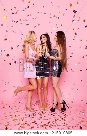 Full Length Portrait Of Blonde Brunette Attractive Sexy Girls In Gold Confetti Celebrating Birthday
