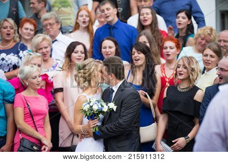 Belarus Gomel Wedding houseJuly 29 2017.The bride and groom kissing after the registry office.Wedding day The bride and groom.Gosts at the wedding. The relatives of the bride and groom