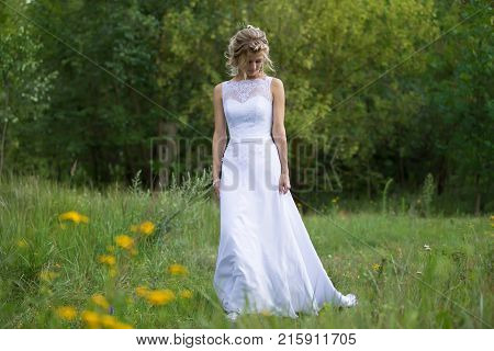 Belarus Gomel July 29 2017.Wedding day.Bride in the forest walking along the road.Wedding day. The bride before the wedding. Beautiful bride.