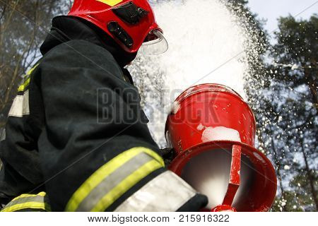 Belarus Gomel 04/06/2017 extinguishing forest fire.Belarus Firefighter extinguishes a fire.Fighting fire. Fire Foam