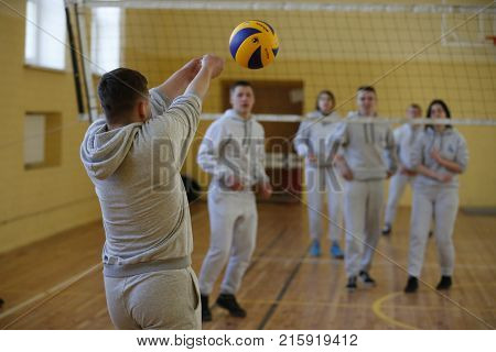 Belarus Gomel 21 April 2017. Open lesson on fire fighting. Volleyball game.Physical education lesson. Young guys play volleyball.
