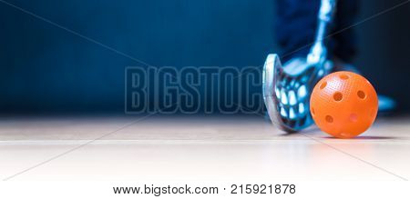 Floorball banner with ball stick and player. Floor hockey concept. Negative copy space.
