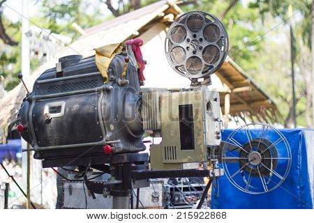 The old  analog rotary film movie projector at outdoor cinema movies theater for show people in the Park at Bangkok Thailand