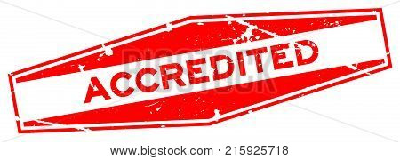 Grunge red accredited word hexagon rubber seal business stamp on white background