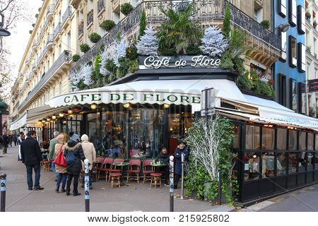 Paris France-November 26 , 2017 :The famous cafe De Flore decorated for Christmas located at the corner of boulevard Saint Germain and rue Saint Benoit .