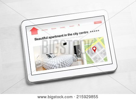 Apartments and houses online search with mobile device. Holiday home rental or real estate website or application. Imaginary internet marketplace for vacation lodging or finding new home on tablet.