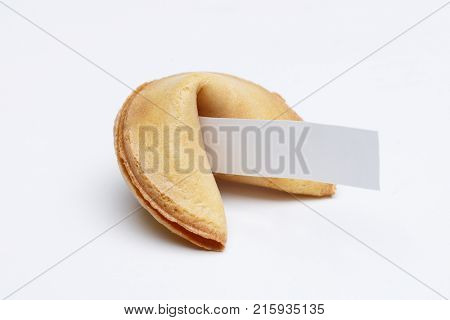 Chinese cookie with wish on empty white background. Empty wish paper