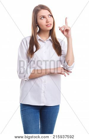 A beautiful, cute girl in a white shirt and jeans came up with an idea and she lifted her finger up on a white isolated background