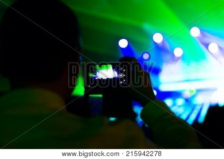 Man Taking Photo Video By Mobile Phone Of Silhouettes Crowd Party Concert Music