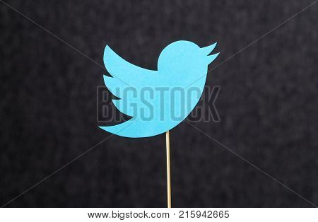 JYVASKYLA FINLAND - JULY 2 2017: Twitter logo cut from cardboard on wooden stick against dark background. Twitter is a social media network that was founded in 2006. Illustrative editorial.