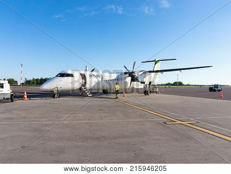 RIGA LATVIA - AUGUST 27 2016: AirBaltic airplane after landing in the airport of Riga. Airbaltic is a latvian low-cost carrier and airline. Editorial.