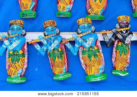 Wood made idols of Lord Krishna handicrafts on display during the Handicraft Fair in Kolkata earlier Calcutta West Bengal India. It is the biggest handicrafts fair in Asia.