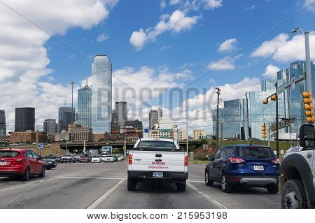 Dallas Texas - June 10 2014: Cars stopped at a traffic light at the entrance of the city of Dallas in Texas USA.