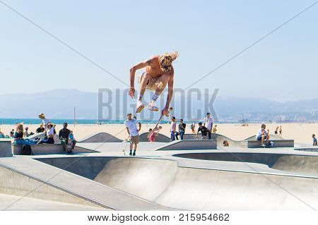 LOS ANGELES USA - AUGUST 23 2017: Talented skateboarder doing tricks in skate park in Venice Beach. Editorial.