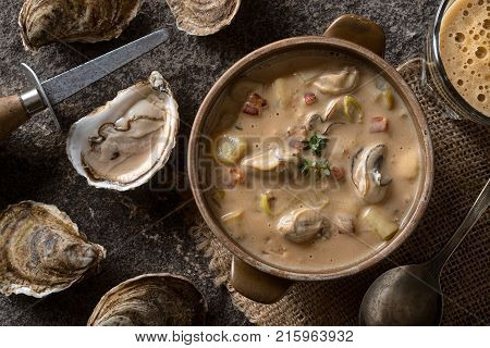 Homemade oyster stew with stout beer bacon and thyme.