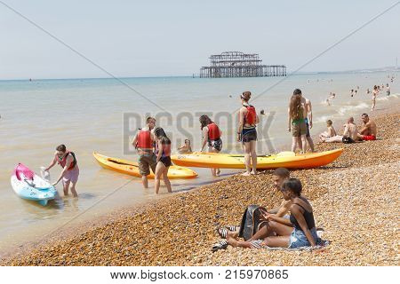 Brighton Great Britain - Jun 17 2017: People Starting A Canoe Excursion And Sunbathing People On The