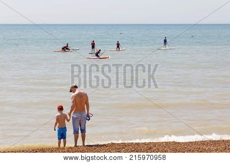Brighton Great Britain - Jun 17 2017: People Practice Stand Up Paddleboarding Outside The Brighton B