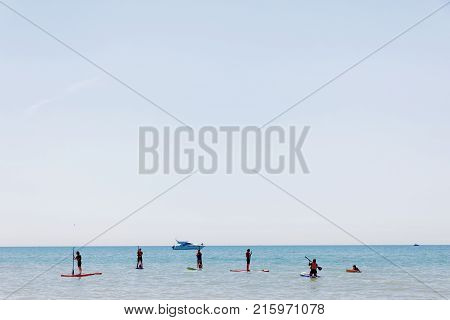 BRIGHTON GREAT BRITAIN - JUN 17 2017: People practice Stand Up Paddleboarding outside the Brighton beach. June 17 2017 in Brighton Great Britain