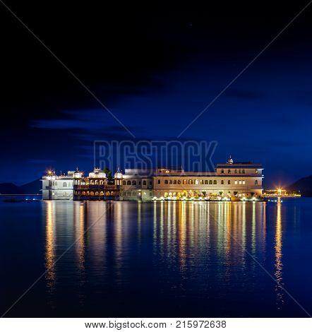 Lake Pichola and Taj Lake Palace at night Udaipur Rajasthan India Asia.