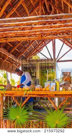 February 2012 Cayo Largo Island Cuba in this period of no rains tourists love to stop at this kiosk serving good juices to enjoythem on the outdoors tables.