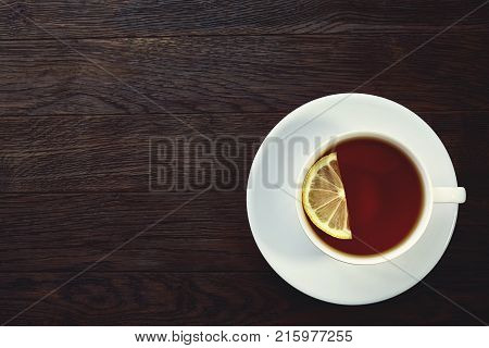 white cup of tea with cookies on a wooden background white cup of tea with cookies on a wooden background. With copy space.