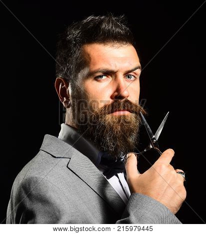 Front View Of Bearded Businessman Having His Beard And Moustache