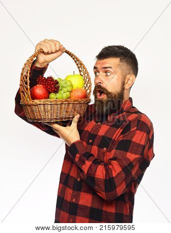 Guy Holds Homegrown Harvest. Farmer With Surprised Face