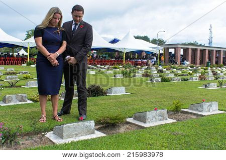 Labuan,Malaysia-Nov 12,2017:People paying respects during the Remembrance Day Lest We Forget at Commonwealth World War II graveyard in Labuan,Malaysia.