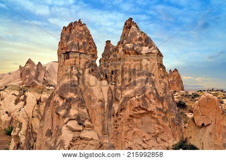 Cavusin Village, Volcanic Rock Formations In Cappadocia, Anatolia, Turkey.