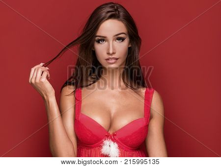 Sexy Brunette Woman In Santa Claus Costume.