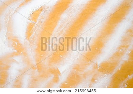 The background of white flour on wooden background light